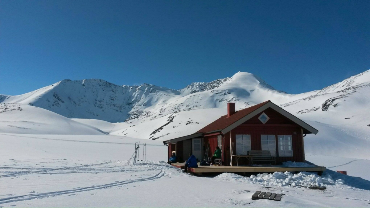 Rørneshytta - red cabin in the mountains in winter