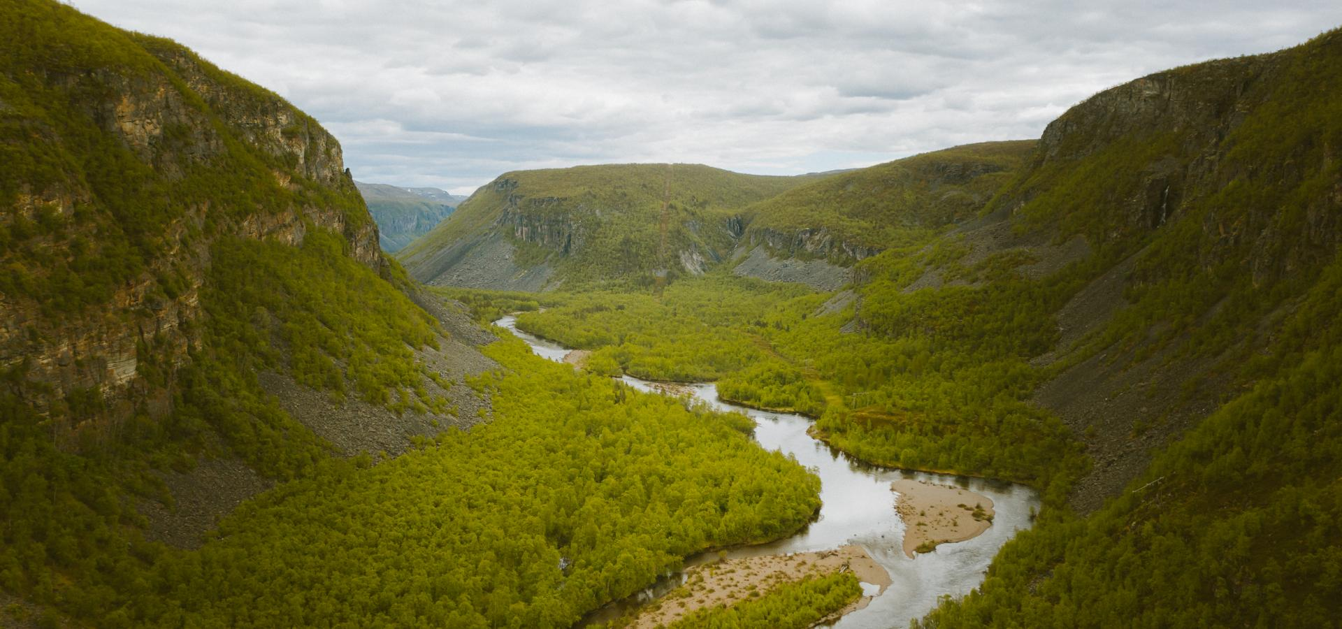 Birdseye view of the Reisa River and the valley with the green forest and the mountainsides
