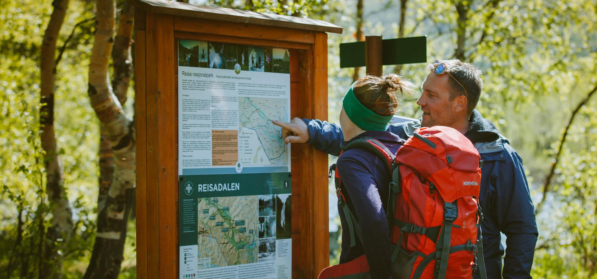Checking the info board in Reisa National Park