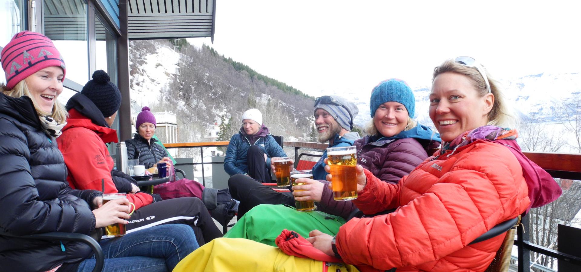 People enjoing afterski on the terrace of Magic Mountain Lodge