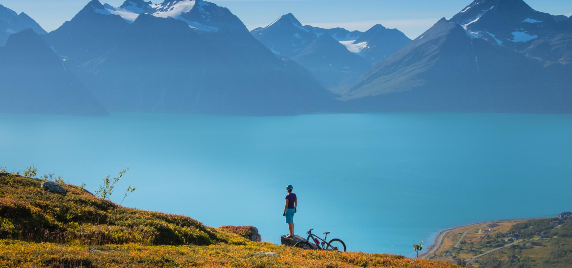 A biker enjoying the view of the Lyngenfjord and the Lyngen Alps