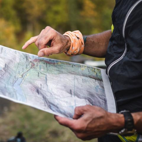 Holding a hiking map while looking at it