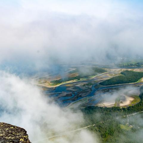 Birdseye view of the Skibotn delta inbetween some clouds