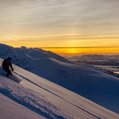 Skitouring in the Lyngen Alps, Northern Norway, under the polar night light